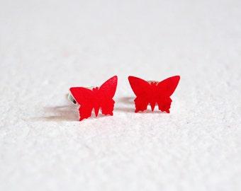 Red butterflies post earrings in shrink plastic