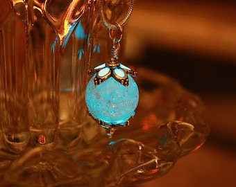 Cracked clear round crystal pendant GLOW in the DARK
