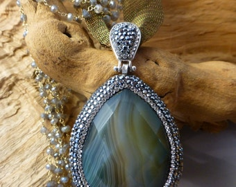 Beautiful large.GEM QUALITY  Agate pendant,set in Sterling and surrounded by Swraovsky stones.