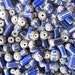 50 Pcs of vintage chevron beads with red and blue tripes cylindrical shape quite large size.