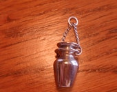 Silver (?) scent vial to be worn on neck chain