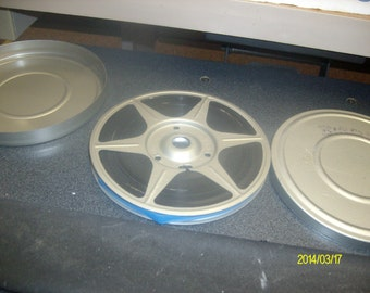 Five inch 8 MM film tin with film inside of birds