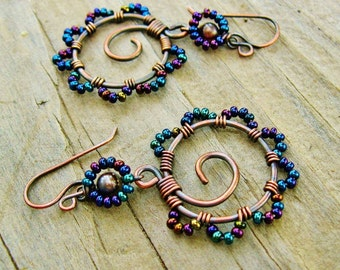 Bead Dance earrings in Iris Blue mix - wire wrapped antiqued copper hoops with seed beaded petals