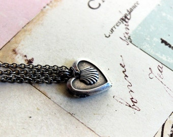 sea shell. locket necklace. silver ox style B