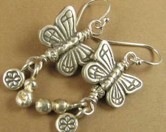 Large butterfly and dangling charm earrings. Fine and sterling silver.
