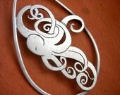 Octopus drop necklace. Hand cut silver.