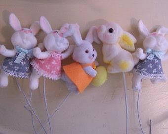 five fuzzy flocked bunny figurines