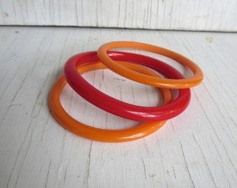 Vintage Bakelite Bangle bracelet set 2 Tangerine Orange Peach Spacer Stacker Bangles 1 red plastic bangle