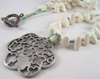 Pastel Bloom.. Silver flower pendant, white wood nuggets & pastel seed bead necklace