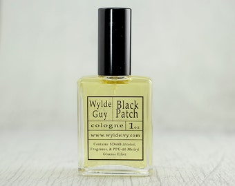 Black Patch Wylde Ivy Guy Men's Cologne 1oz with notes of Patchouli, Black Pepper, Woods, Ginger, Orange, and Amber