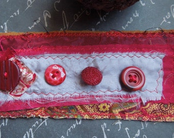 Red Textile Cuff with 4 Red Buttons