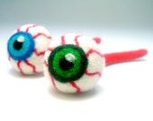 Catnip cat toy green bloodshot eyeball with red veins and optic nerve all felted wool in a specimen cup!