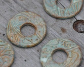 Seagreen Pottery Washer Bead in the whimsy pattern