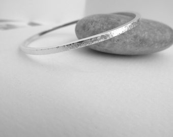 Handmade Sterling silver, organic solid Bangle made by Norita Designs