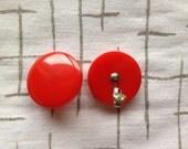 Red Bakelite button earrings, clip ons.