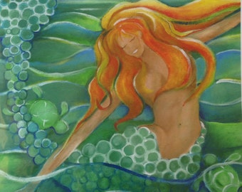 Teal tail redhead mermaid with playing with turtles