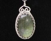 Labradorite pendant set in fancy sterling silver bezel