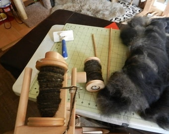 Handspun keepsakes from your Beloved Pet.  Have your pets fur hand spun ready for you to knit yourself or have me create a keepsake for you.