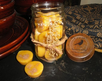 Jar of Beeswax Tarts made of 10 mini organic beeswax melting tarts scented in a mason jar with rusty lid and tied with sweet annie