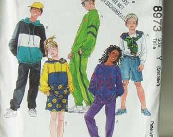 McCall's 8973 Children's Sewing Pattern SALE Easy to Sew Boy's & Girl's Pullover Top Knit Pants and Shorts Elastic Waist Pants Size 7 - 10