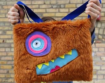 Tan open top monster bag.