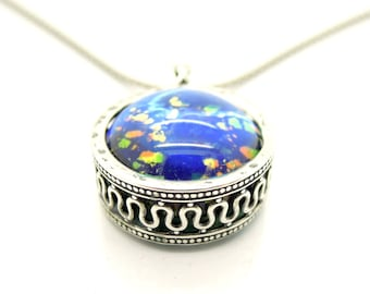 Blue murano necklace in a sterling silver round pendant