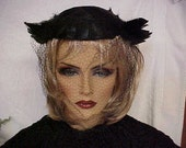 Reserved. You 1940's Unusual fascinator hat with shinny black feathers and side like feather wings- has face veil