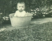 Wash Day Baby Bath in Metal Bucket Tub Outside Sidewalk Flower Garden 1920s Antique Vintage Black and White Photo Photograph