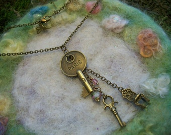 Necklace, Key to Paris and a Chair