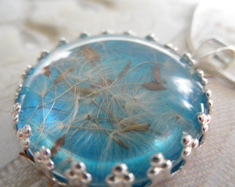 Dandelion Seed Crown Pendant Atop Glowing Turquoise Background-Gifts Under 25-Nature's Wearable Art-Symbolizes Happiness