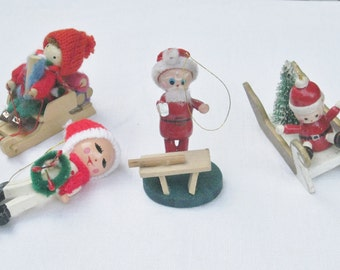 Vintage Wood Christmas Ornaments Figurines Four Hanging Christmas Tree Trimmings Painted Child Knit Hats Santa in Sleigh Bottle Brush Tree