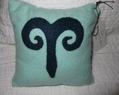 two zodiac pillows (similar to the photo)