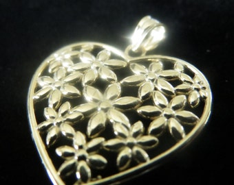 Gold plated Sterling silver flowers in a heart pendant