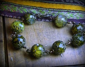 Dragons in the Fields Bracelet. chunky dragon vein agate and Victorian filigree caps- bracelet.