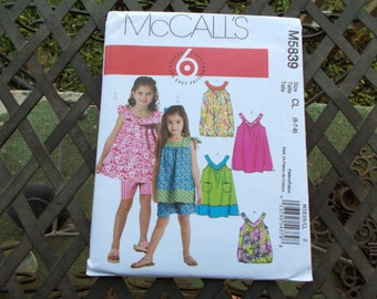Sewing Pattern new and uncut McCall's out of print M5839 Children and Girl's Tops Dresses Shorts
