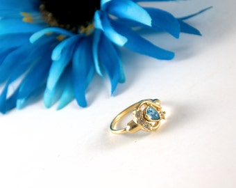 Vintage Avon Aqua Blue and Crystal ring, gold tone pear shape, size 7.5, blue topaz