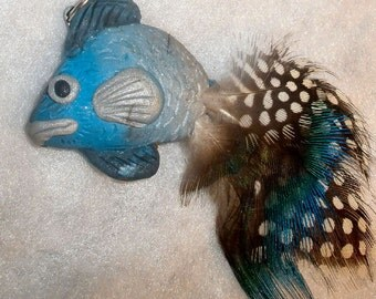Feathered fish pendant fun and colorful peacock feathers