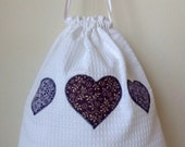 White cotton drawstring bag with purple applique hearts