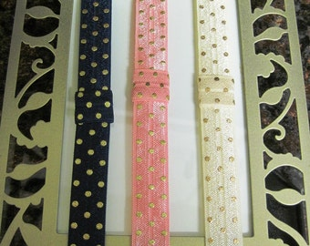Choice of pink and gold, ivory and gold, or navy and gold stretch headbands with accessory tab