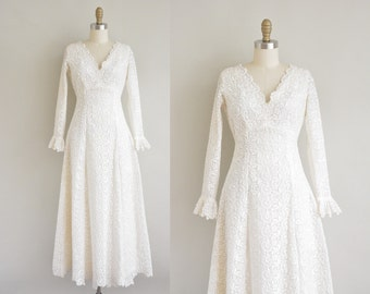 vintage 1960s wedding dress / white heavy embroidered dress / 60s lace dress