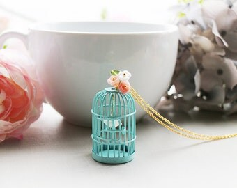 Birdcage Necklace. whimsical bird cage in blue with pink flowers and sea shell bird