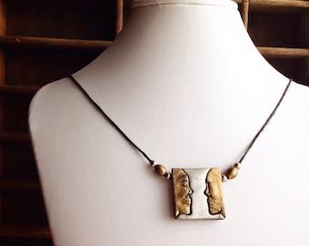 Vintage JJ Necklace / Faces Profile / Brass Pewter / Corded Pendant