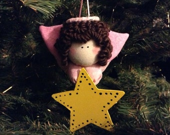 Primitive Brunette  Angel with a Pink Body and Pink Wings holding a Star Ornament