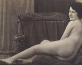 Marked Down 50% Nude French Model lounging on Oriental Rugs and Cushions, circa 1920 by SAPI