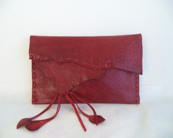 red leather handbag clutch with black leather lining and hand whip stitching and leaf fringe by Tuscada. Ready to ship.