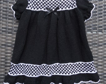 Dress for a baby girl hand knitted in black/white yarn, age approx 12-18 months, vintage pattern, Goth/Emo?