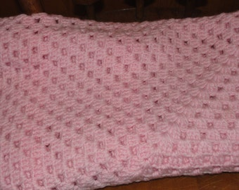Crocheted pink baby or lap afghan
