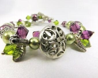 Green and Purple Swarovski Pearl ornate Bracelet with charms