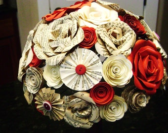 the Cara bridal bouquet in red and wine mixed paper roses, book page roses spiral roses and pinwheel fan folded flowers