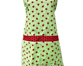 Lady bugs in green   apron